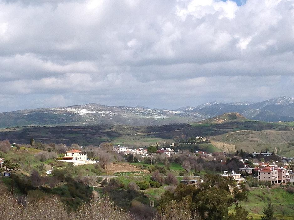 The-village-of-Goudi-with-the-snow-covered-peaks-of-Troodos-in-the-distance1
